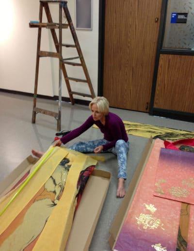 Preparing kimono parts for installation at SSH Gallery