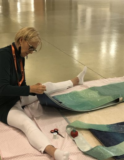Sewing the sleeves of Kai's Song setting up at the Florence Biennale